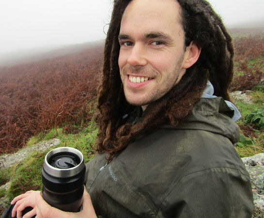 Me holding a flask of tea on a misty hill in Llanmadoc, Wales. Picture taken in the Autumn of 2016.